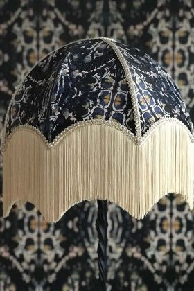 lifestyle image of Anna Hayman Designs Siouxsie Lamp Shade with matching wallpaper background