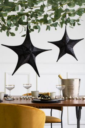 Lifestyle image of the small & large Black Glitter Stars
