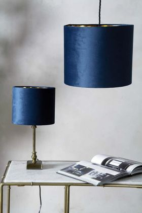 Image of both the sizes available for the Marine Blue Velvet Lamp Shade on a lamp & a ceiling light