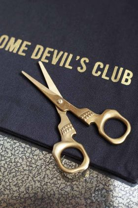 Lifestyle image of the Gold Skull Scissors on the RSG Handsome Devil's Club Pouch