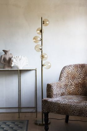 Lifestyle image of the Glass Globe Bar Floor Lamp