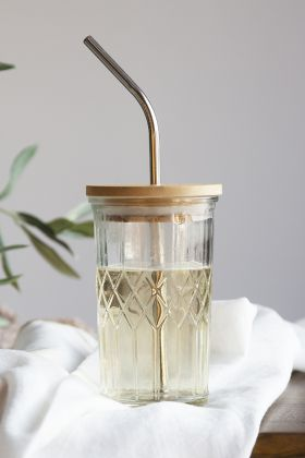 Lifestyle image of the Glass Tumbler With Bamboo Lid & Stainless Steel Straw