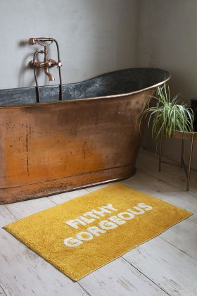 Lifestyle image of the Gold Filthy Gorgeous Bath Mat
