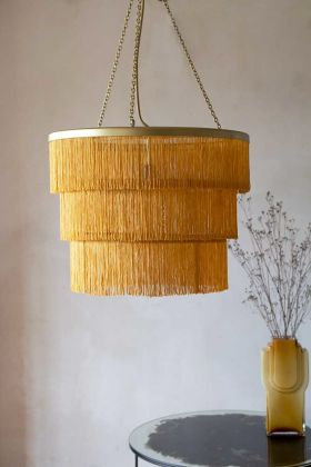 Lifestyle image of the Gold Three-Tier Fringe Chandelier