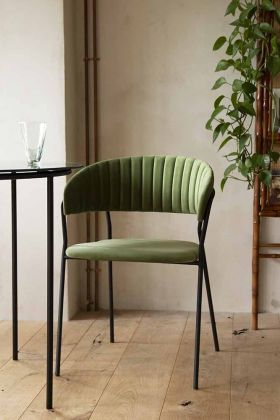 Lifestyle image image front on of the Curved Back Velvet Dining Chair In Moss Green