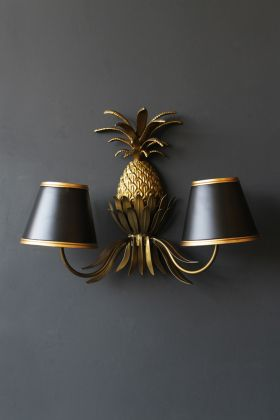 lifestyle image of Gold Pineapple Wall Light hung on dark grey wall