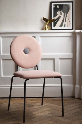 Lifestyle image of the Modern Round Back Dining Chair In Blush Pink