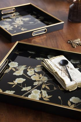Lifestyle image of the Set Of 2 Black & Gold Ornate Trays