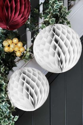Lifestyle image of the Set Of 2 Honeycomb Ball Decorations In White
