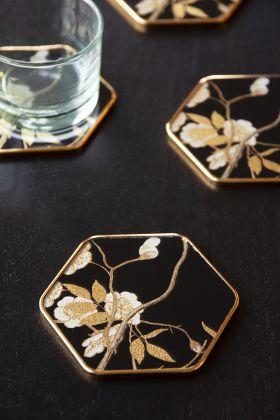 Lifestyle image of the Set Of 4 Black & Gold Ornate Coasters
