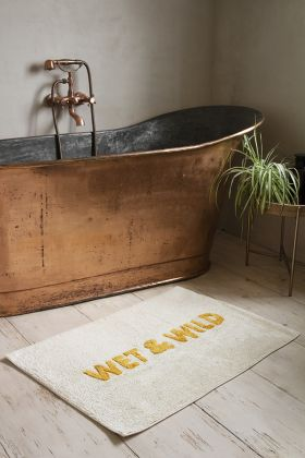 Lifestyle image of the White & Gold Wet & Wild Bath Mat