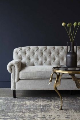 Lifestyle image of the right end of the Soft Grey Modern Chesterfield 3 Seater Sofa