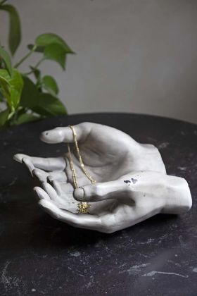 Lifestyle image of the Distressed Effect Grey Giving Hands Ornament / Trinket Dish