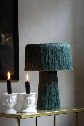 Lifestyle image of the Jade Green All Over Fringe Table Lamp next to candles