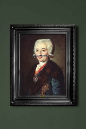 lifestyle image of the blue pencil canvas with printed frame coloured portrait with blue pencil in mouth and black frame on green wall background