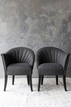 lifestyle image of the lovers herringbone tweed chair - homme grey with grey wall background