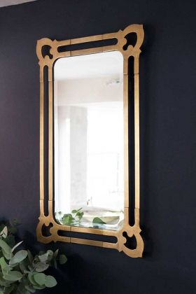 Image of the Tudor Inspired Wall Mirror hanging on the wall