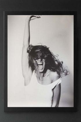 lifestyle image of Unframed Eloise Poster in black frame on dark grey wall background