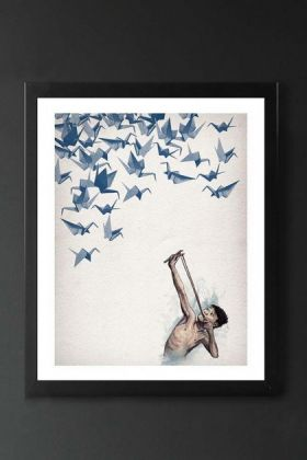 lifestyle image of unframed lucky shot fine art print boy aiming sling shot at blue paper birds in black frame on dark wall background
