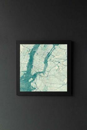 lifestyle image of Unframed New York Map Blue Vintage Art Print in black frame on dark wall background