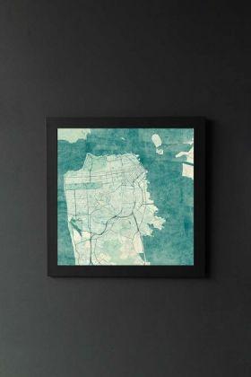 lifestyle image of Unframed San Francisco Map Blue Vintage Art Print in black frame on dark wall background
