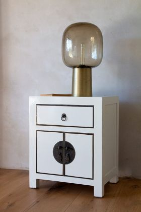 Angled lifestyle image of the Oriental Gloss White Bedside Table