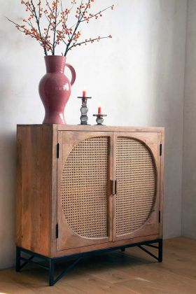 Lifestyle image of the Woven Cane Two-Door Cupboard