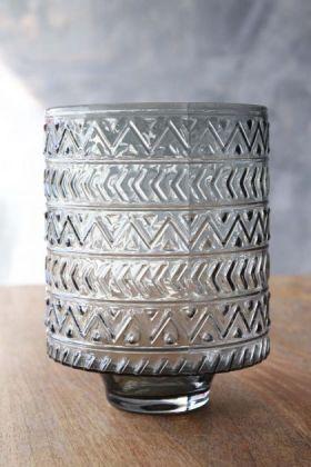 lifestyle image of Zig Zag Hurricane Tea Light Holder / Vase on wooden table with grey wall background