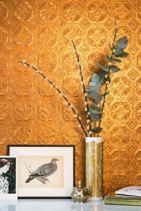 lifestyle image of anaglypta derby wallpaper - white behind white table with gold vase and eucalyptus