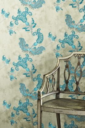 lifestyle image of barneby gates paisley wallpaper - turquoise on old grey with distressed chair in front