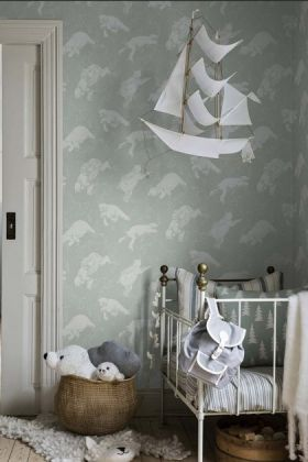 lifestyle image of BorasTapeter Scandinavian Designers Mini Collection Wallpaper - Polar with white crib and hanging white ship ornament