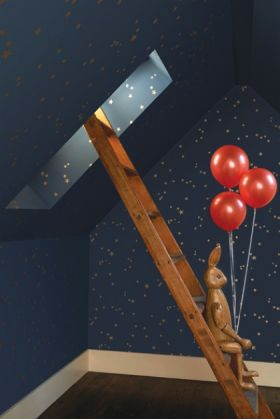 lifestyle image of cole & son whimsical collection - colour stars wallpaper - 3 colours available with brown ladder and rabbit figure holding red balloons