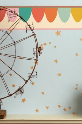 lifestyle image of cole & son whimsical collection - scaramouche border - 3 colours available with ferris wheel ornament