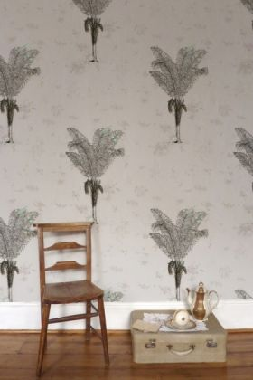 lifestyle image of elli popp desert grove wallpaper - mauve with wooden chair and beige suitcase with white and gold tea set on top