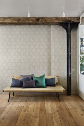 lifestyle image of Engblad & Co Atmospheres Collection - Medium Brush Wallpaper - 3 Colours Available with wooden beam on ceiling and sofa with blue toned cushions