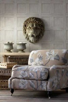 lifestyle image of andrew martin engineer collection - regent wood panelling wallpaper - 3 colours available with lion head on wall and patterned armchair