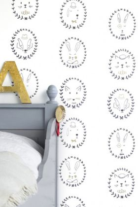 "lifestyle image of hibou home picture perfect portraits children's wallpaper - black/gold/white with grey bed with white bedding and yellow ""A"" letter decoration"