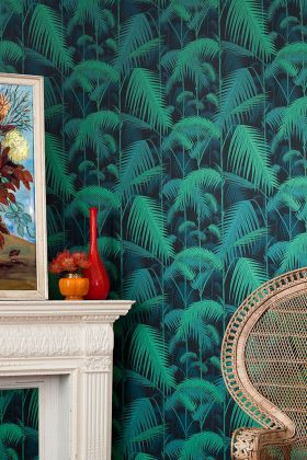 lifestyle image of cole & son contemporary restyled - palm jungle wallpaper - green on black