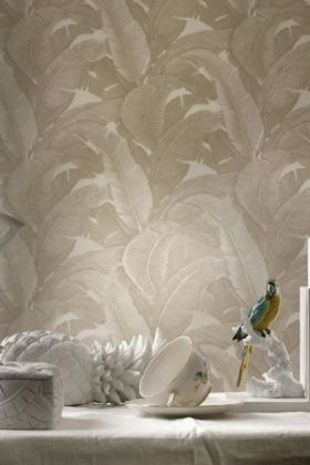 lifestyle image of teide tropical leaves wallpaper - lights - 2 colours available behind white unit with white ornaments on top