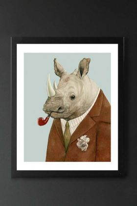 lifestyle image of unframed rhino fine art print rhino in suit smoking a pipe in black frame on dark wall background