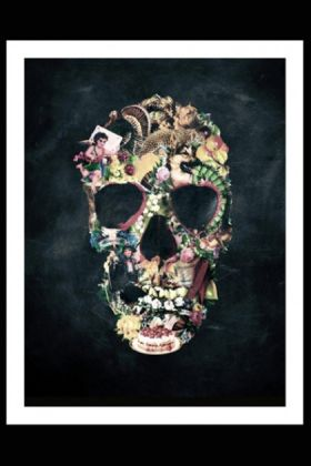 lifestyle image of unframed vintage skull fine art print in white frame on black background