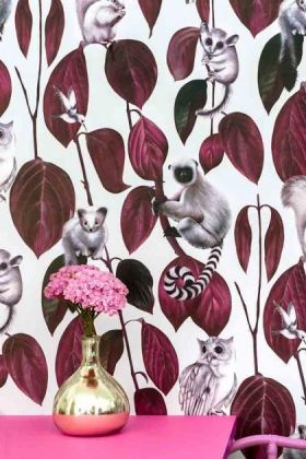 lifestyle image of witch & watchman siberia wallpaper - light with pink table and gold vase with pink flowers in