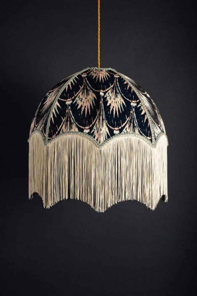 lifestyle image of Anna Hayman Designs Pearl Pendant Shade turned off on dark blue wall background