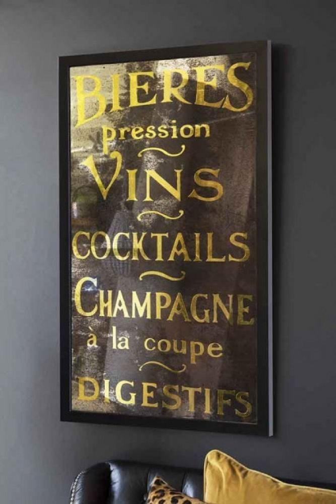 Lifestyle image of Antique Effect Bieres, Vins, Cocktails & Champagne Typography Mirror hanging on dark grey wall above sofa