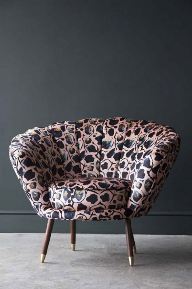 lifestyle image of Bespoke Oyster Shell Armchair with grey flooring and dark wall background