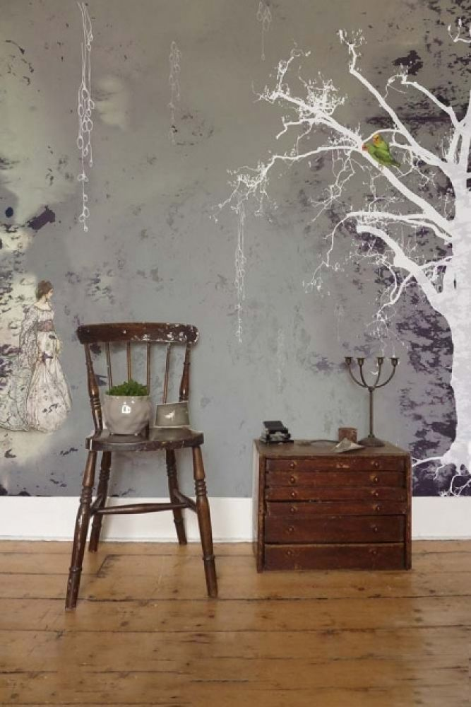 lifestyle image of elli popp aurora borealis wallpaper with wooden chair and wooden side table with candlestick on