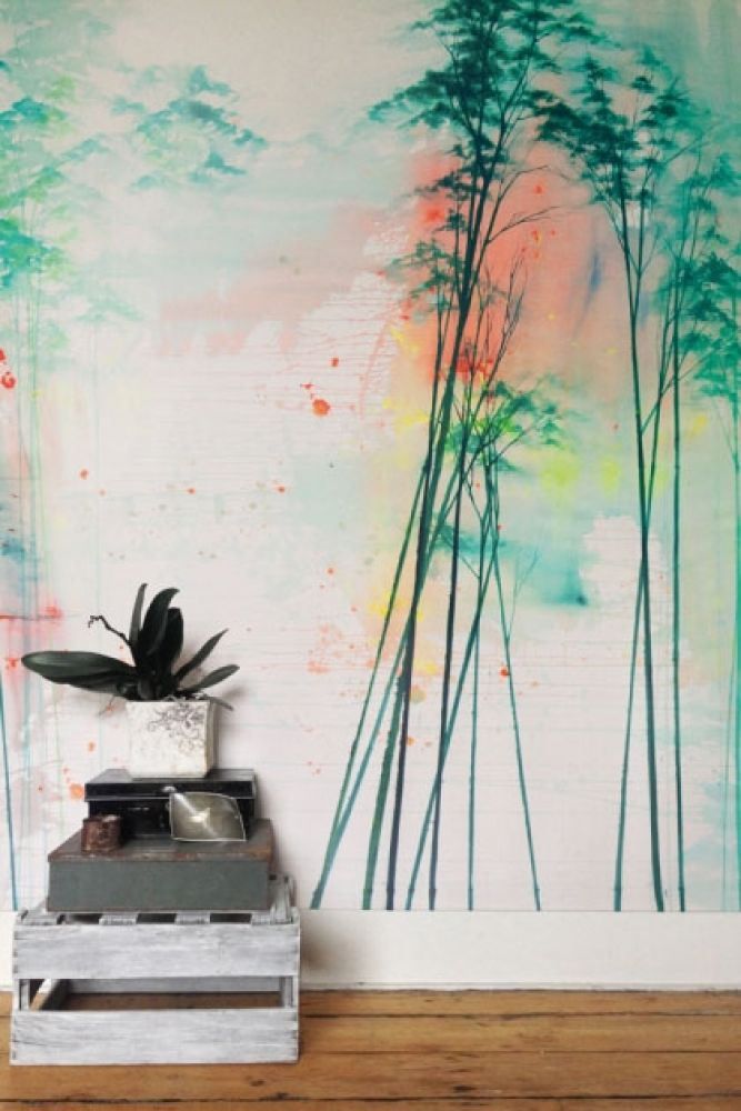 lifestyle image of elli popp see into the trees wallpaper - daytime with grey wooden pallet and plant in pot on wooden floor