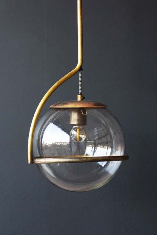 Close-up lifestyle image of Glass Globe Ceiling Light on dark grey wall background
