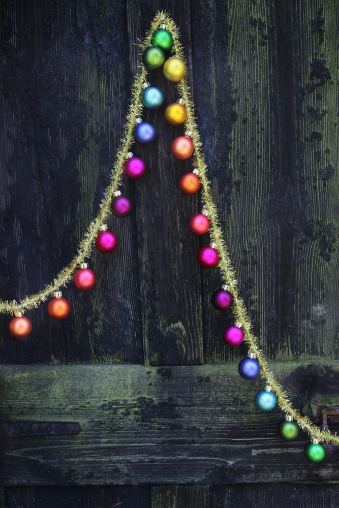 Zoomed out image of the Rainbow Multicoloured Baubles & Tinsel Garland draped3