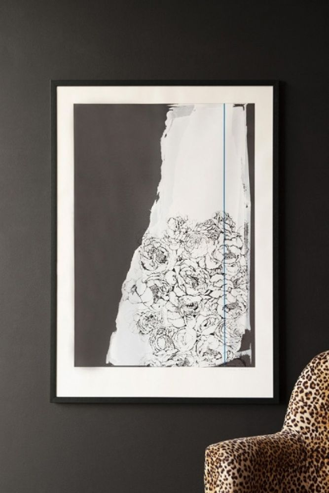 Lifestyle image of the Hand Screen Printed Floral Zeitgeist Portrait Artwork By Lizzie Coles hanging on dark grey wall above Rockett St George Leopard Love Armchair